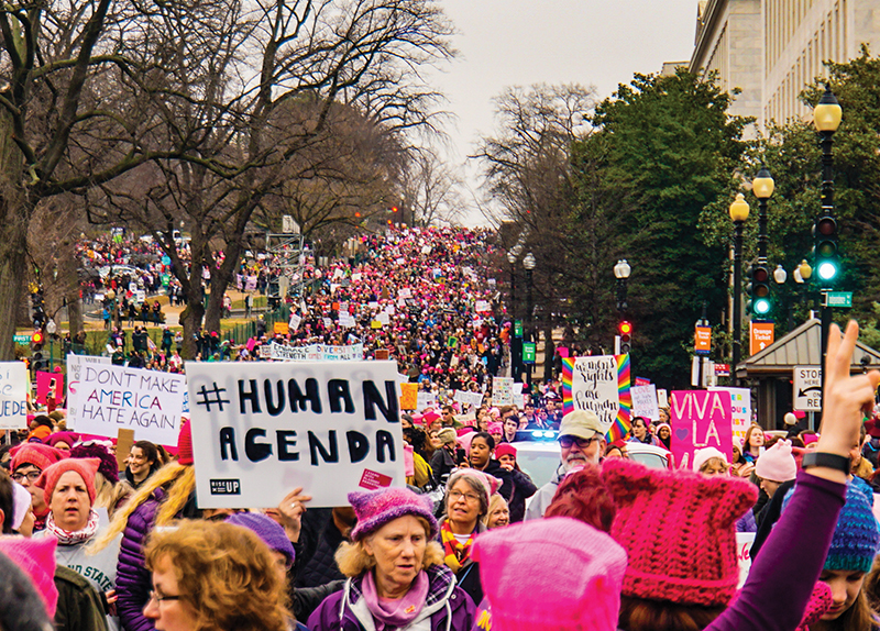 Woman in Iconic Photo Marches Again