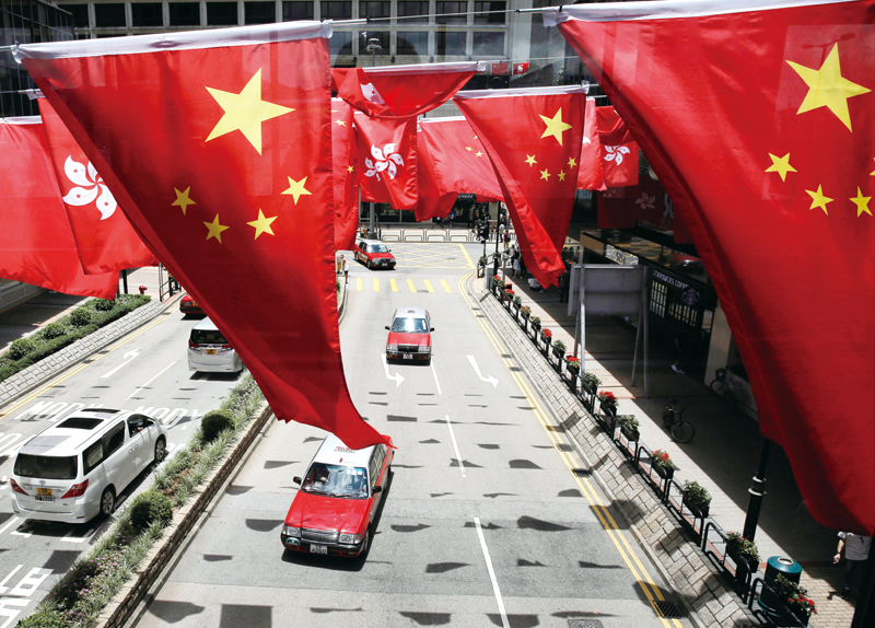 China Extends Anthem Law To Cover Hong Kong, Macau - World on the Move